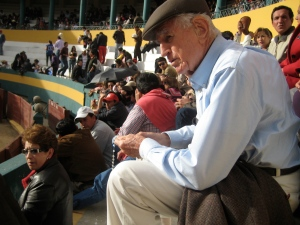 My Grandfather prays the rosary for his son before a bullfight.