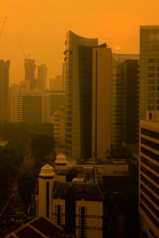Singapore's sunrise, seen through the pollution haze.