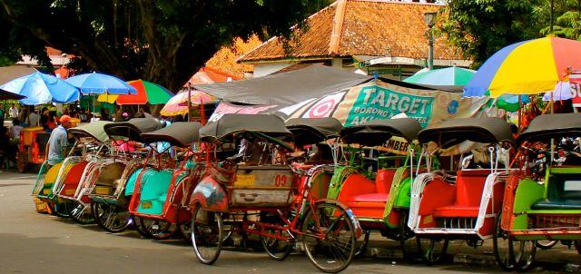 A line of becak waiting passengers in Yogyakarta