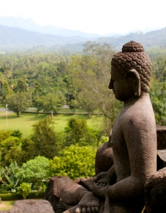A statue of the Buddha looks out over Borobudur, central Java.