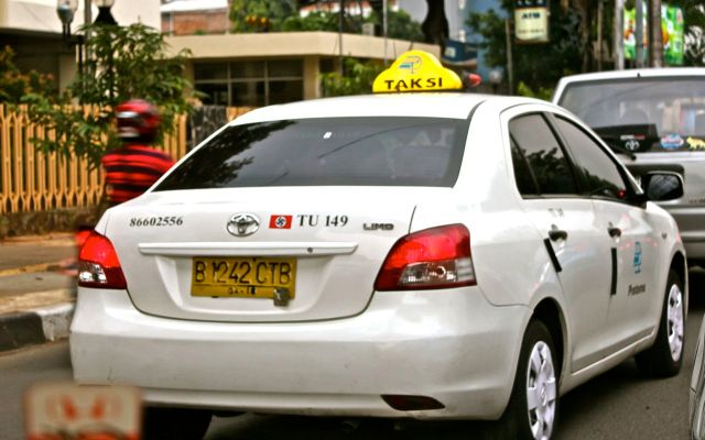 This Jakarta taxi sports a surprising bumper sticker.