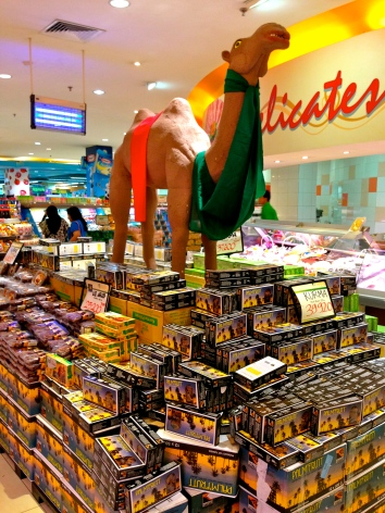 Though camels are not to be found anywhere in Indonesia, they might remind shoppers of Mecca, the home of Islam. This one draws attention to a supermarket display of fancy dates.