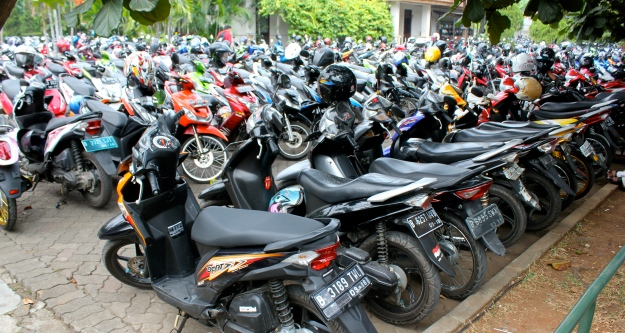 With a motorcycle, parking at Jakarta's crowded malls is a little more efficient.