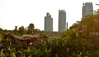 Jakarta slums against a back drop of high rise apartments