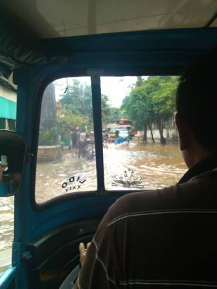 The driver of this motorcycle- taxi asked my co-worker to get out and walk because the water was too deep. (Photo: Juairia Sitabutar)