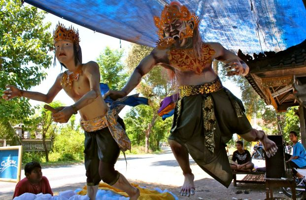 "A demon chases a young prince in this ""ogoh-ogoh,"" made out of bamboo and papier-mache by children (pictured) of Pemuteran, Bali."
