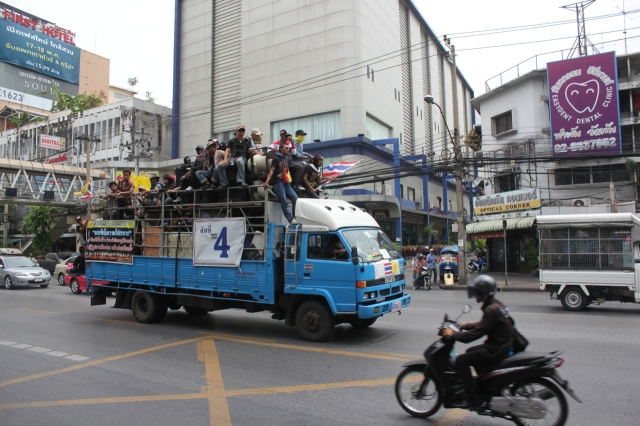 A truck full of protesters barrels through the streets of Bangkok a few days before the military coup in Thailand.