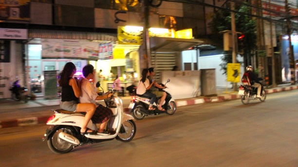 Thais look fabulous whizzing by on scooters in the Chiang Mai night. Tourists don't always fare as well.